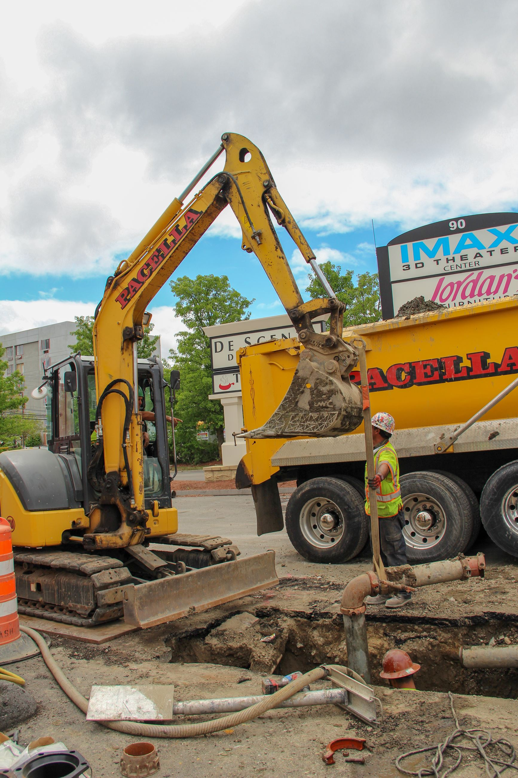 Excavator removing temporary water bypass pipe from Worcester Road